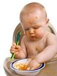 Comida ou Papinha para Bebês - Produtos Orgânicos, Alimento Orgânico. bebê comendo papinha